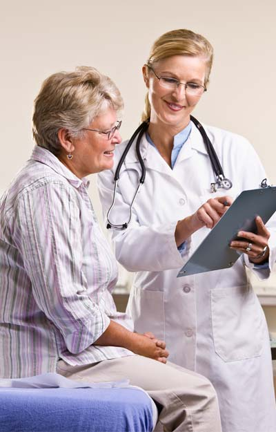 Chiropractor-Explaining-to-Patient.jpg